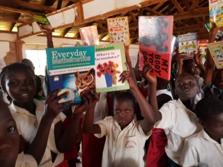 Students holding some of the donated items