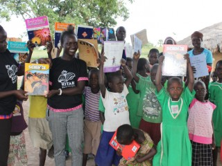 Students of Ousia Primary School with the Kitabu-Buk Project officials